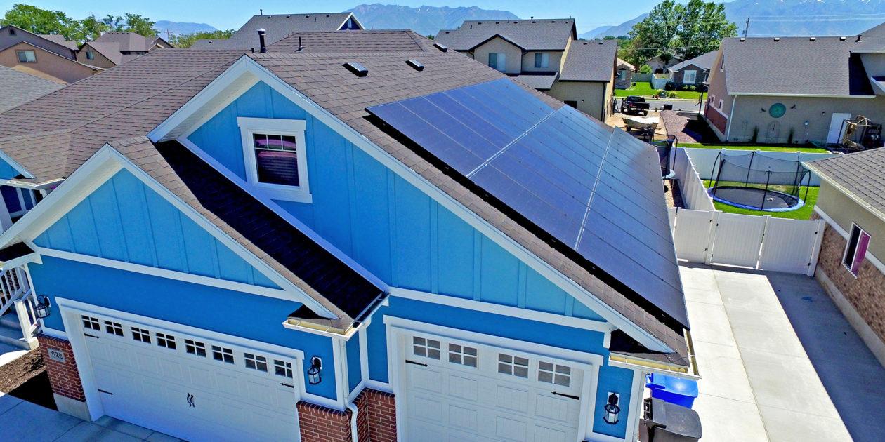 blue house black solar panels