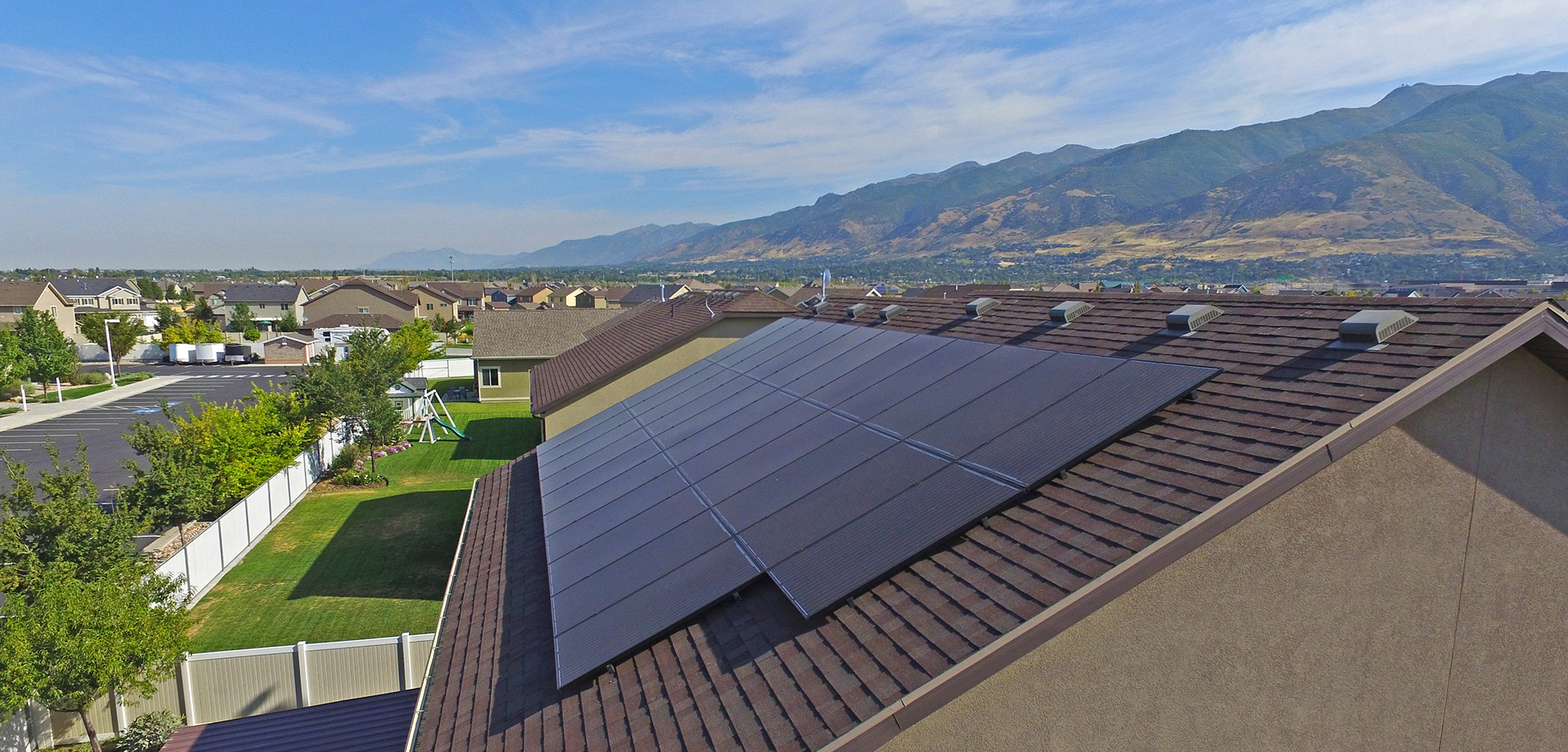 shot of brown house with black solar panels