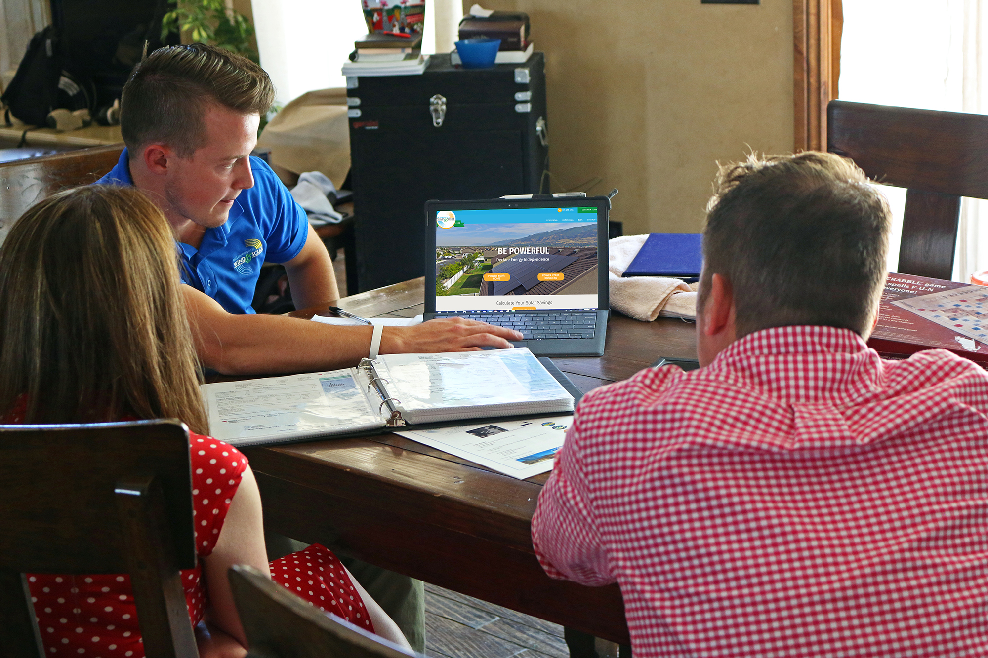 Photo of Intermountain Wind & Solar employee giving a one on one consultation