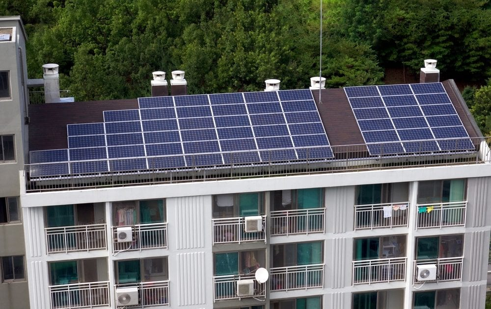 Solar panels installed on apartment buildings can attract tenants and save landlords money.